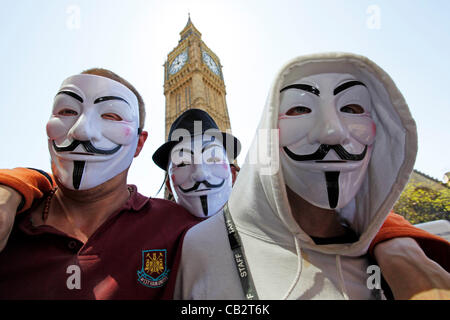 London, UK. Saturday 26th May 2012. Anonymous forming up at Parliament Square, in front of Big Ben in Westminster, - Stock Photo