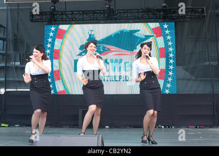 Girls in 1940s era dress perform aboard the Intrepid Sea, Air and Space Museum during Fleet Week in New York City, - Stock Photo