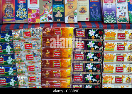 Boxes of Incense Sticks for sale on a market stall in India - Stock Photo
