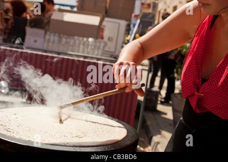 High Noon community festival is a Northcote local music fest in Melbourne, Australia making food / crepes on the - Stock Photo