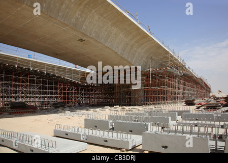 Road construction site in Dubai. Shows the new Jafza Bridge, part of the elevated section of the new Parallel Road - Stock Photo