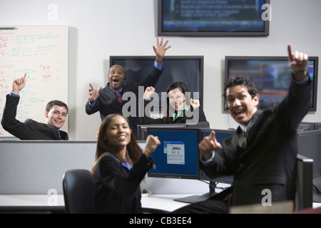Business people cheering in an office - Stock Photo