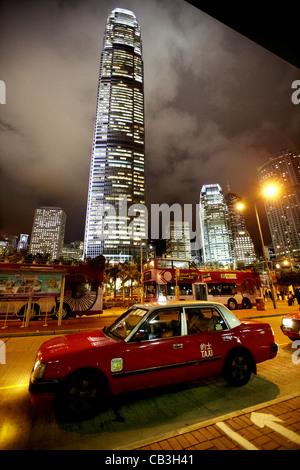 hong kong red taxi at taxi rank at night in front of international finance centre 2 on hong kong island, hksar, - Stock Photo