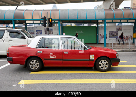 hong kong red taxi hong kong island hksar china - Stock Photo