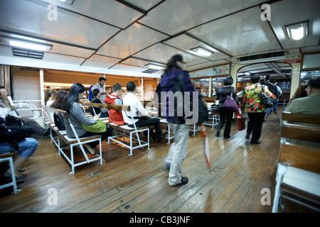 passengers on board the star ferry at night hong kong island, hksar, china motion action blur - Stock Photo