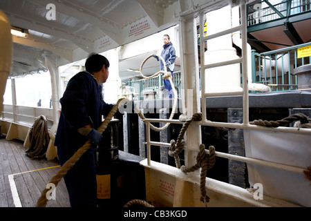 crewmen with mooring rope on star ferry hong kong island hksar china - Stock Photo