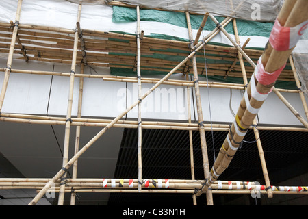 bamboo scaffolding on a building in hong kong island hksar china - Stock Photo