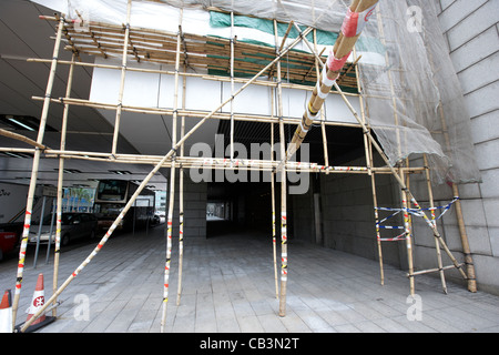 bamboo scaffolding on a building in hong kong island hksar china - Stock Photo