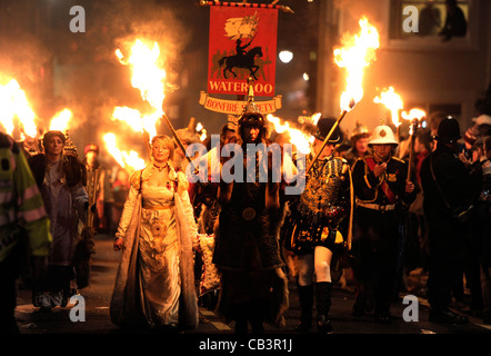 Procession in Lewes bonfire night celebrations showing Waterloo Bonfire society - Stock Photo