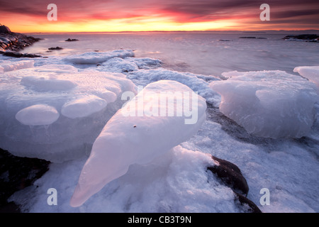 Colorful evening and ice formations at Nes on the island Jeløy in Moss kommune, Østfold fylke, Norway. - Stock Photo