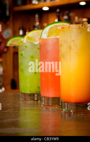 Close up of frosty cocktails on bar counter - Stock Photo