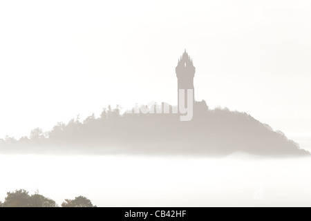 The National Wallace Monument in fog on Abbey Craig, near Stirling, Scotland, UK - Stock Photo