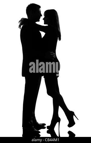 one caucasian lovers couple man and woman hugging tenderness in studio silhouette isolated on white background - Stock Photo