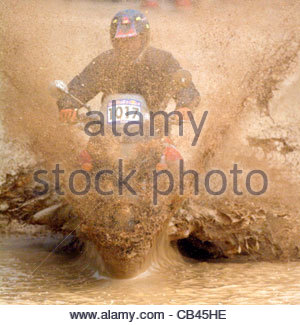 MOTORBIKE,STUNTS,Germany,stunrman,stunt,driving,through,mud,water,pond,muddy - Stock Photo
