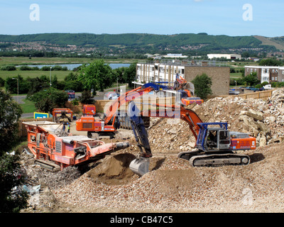 JCBs in operation on a building site in Eastbourne, East Sussex, England - Stock Photo