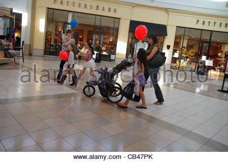 Boca Raton Florida Boca Center centre shopping mall Pottery Barn front entrance woman mother girl daughter balloons - Stock Photo