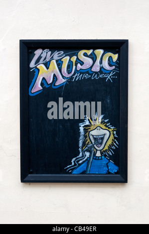 A sign outside a public house for displaying the names of Live Music acts that will be performing - Stock Photo