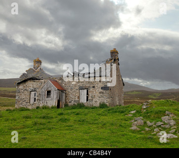 Derelict Crofters Cottage near the A924 in Perthshire, Scotland. - Stock Photo