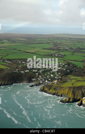 The pretty hamlet of Cadgwith tumbles down to the sea at Cadgwith Cove on the east side of the Lizard Peninsula - Stock Photo