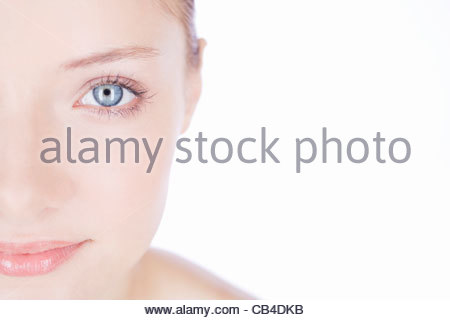 A young woman showing the left half of her face, cropped - Stock Photo