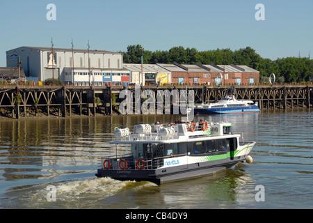 The Nantes waterbus called Navisbus heads towards the Île de Nantes on the Loire River - Stock Photo