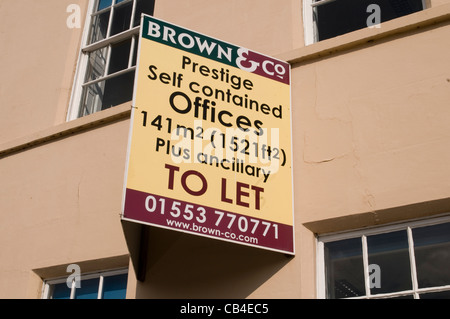 office to rent business premises to let sign empty vacant - Stock Photo