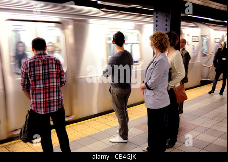 Travelling on subway train in Manhattan New York NYC USA America - Stock Photo