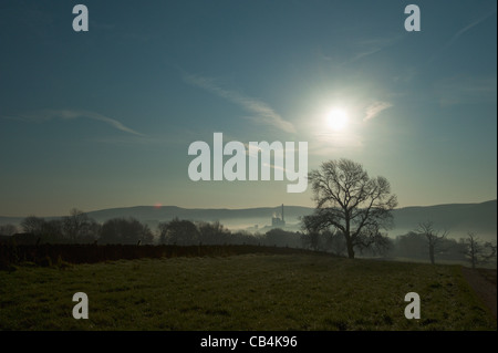 Misty morning in the Hope Valley Derbyshire looking towards the Castleton cement works. - Stock Photo