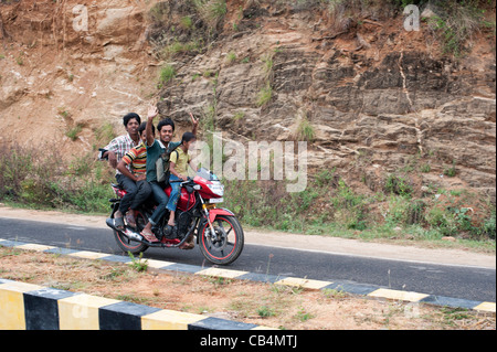 Three Indian teenagers and young girl riding dangerously on a motorcycle. Andhra Pradesh, India - Stock Photo