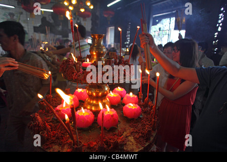 People lighting candles and preying at Goddess of Mercy Temple. Georgetown, Penang, Malaysia, Southeast Asia, Asia - Stock Photo