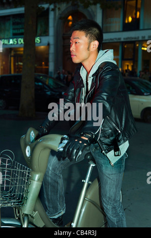 Paris, France, Young Chinese Man on Velib Bicycle, Cycling at Night - Stock Photo