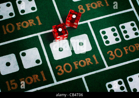 Casino dice roll snake eyes on a craps table felt - Stock Photo
