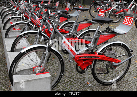 DB Call a Bike bicycles stand ready to use at a parking station in Berlin, Brandenburg, Germany. - Stock Photo