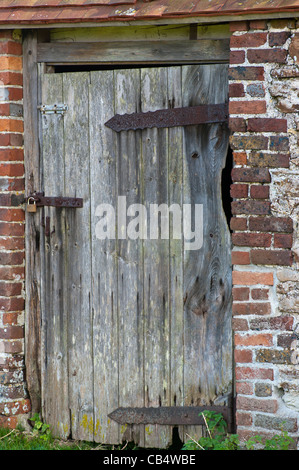 Old Wooden Wood Rustic Door Locked With A Padlock - Stock Photo