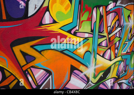 Horizontal close-up of a wall covered with graffiti - Stock Photo