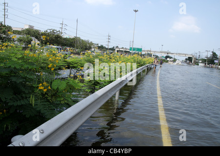 Floodwater on street in Bangkok - Stock Photo