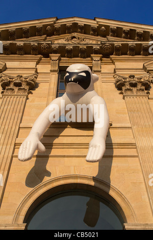 Inflatable sculpture on facade of the Louvre museum as part of the international contemporary art fair FIAC, Paris, - Stock Photo