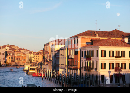 The Moon rises over Riva de Biasio region of Venice, Italy, with the Grand Canal on the left - Stock Photo