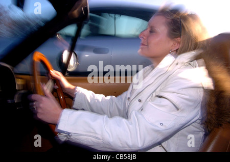 Motoring feature on female drivers or ladettes being more aggressive behind the wheel of a car - posed by model
