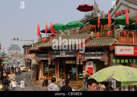 View of Hutong intersection and Bell Tower from Yinding bridge between Houhai and Qianhai lakes Beijing Peoples - Stock Photo