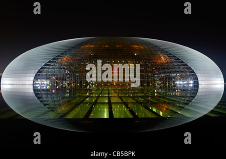 National Centre for the Performing Arts egg lit at night and reflected in water of pool Beijing Peoples Republic - Stock Photo