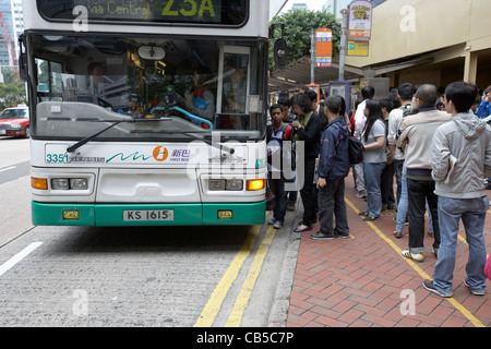 chinese people boarding a bus in downtown admiralty district hong kong island hksar china - Stock Photo