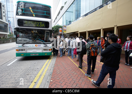 chinese people queueing for a bus in downtown admiralty district hong kong island hksar china - Stock Photo