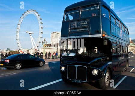 Ghost Bus Tour Bus crossing Westminster Bridge, London, England - Stock Photo