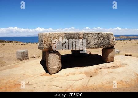 A stone table used for human sacrifice on Isla del Sol in Lake Titicaca, Bolivia - Stock Photo