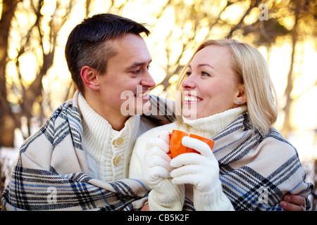Photo of happy man and pretty woman having nice time outdoor in winter - Stock Photo