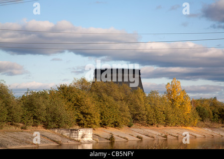 The cooling tower for the unfinished Chernobyl reactors 5 and 6 on the Pripyat or Prypiat River Chernobyl Ukraine - Stock Photo