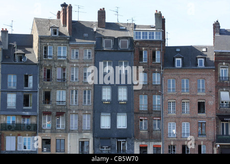 View of the port in Honfleur, Normandy, France. Houses with typical style, and old windows, boats, see - Stock Photo