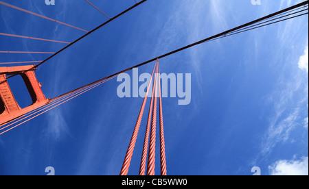 Looking towards the sky along tension cables of the Golden Gate Bridge, San Francisco, California - Stock Photo