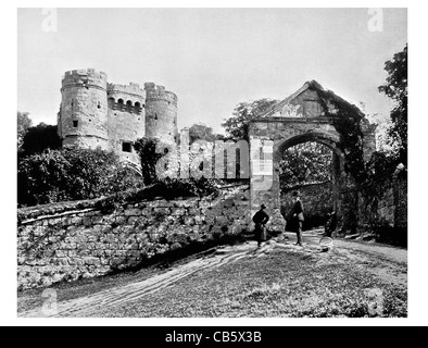 Carisbrooke Castle motte and bailey Newport Isle of Wight England Entrance gateway wall turrets - Stock Photo
